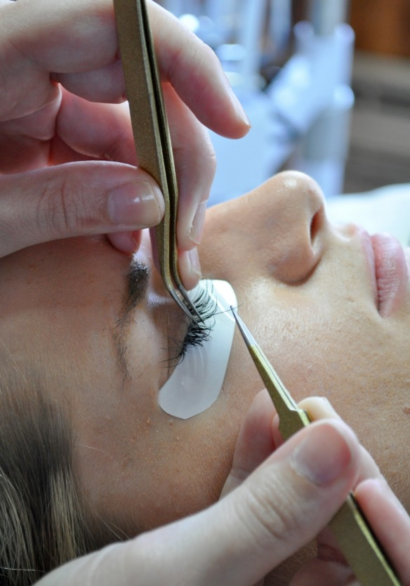 eyelash extensions process closeup